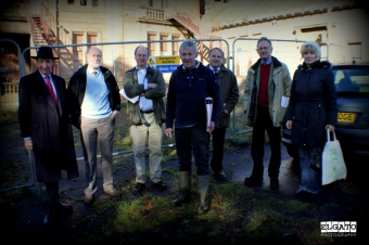Group of experts and committee members standing outside the derelict building of Seafield House