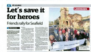 Press cutting from the Ayrshire Post of article by Ewin Lawrence reporting on the Public Meeting held in Ayr on 1 December 2012 with a photograph of campaigners outside Seafield House.