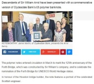 screenshot of online newspaper article with photo of Arrol family
