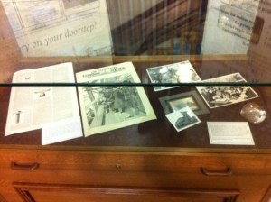 Photo of display cabinet containing photographs andmemorabilia about Sir William Arrol and Seafield House