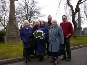 A group of Friends of Seafield House and members of the Arrol Family pictured beside the Arrol grave where the wreath was laid.