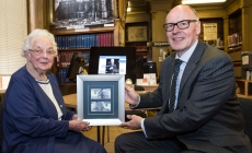 photograph of Ellen Arrol holding the framed notes with Jamie Martin