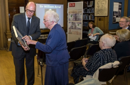 photograph of special commemorative banknote being presented to Ellen Arrol by Jamie Martin