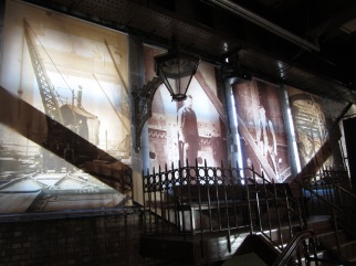 Photograph of 4 banners displaying different images of steelworkers during construction