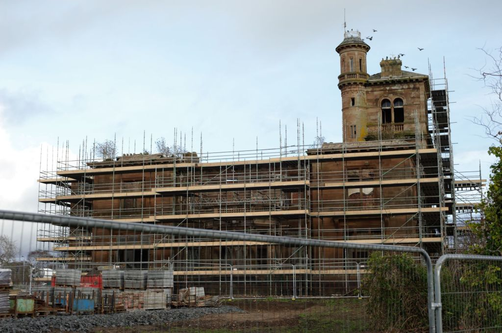 Seafield House surrounded by scaffolding with the tower and turret sticking out above