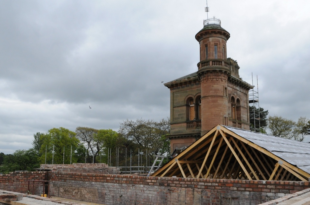 Looking towards the tower of the house with new roof and brickwork in foreground