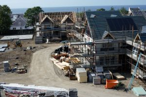 New build houses with roofs at different stages of construction